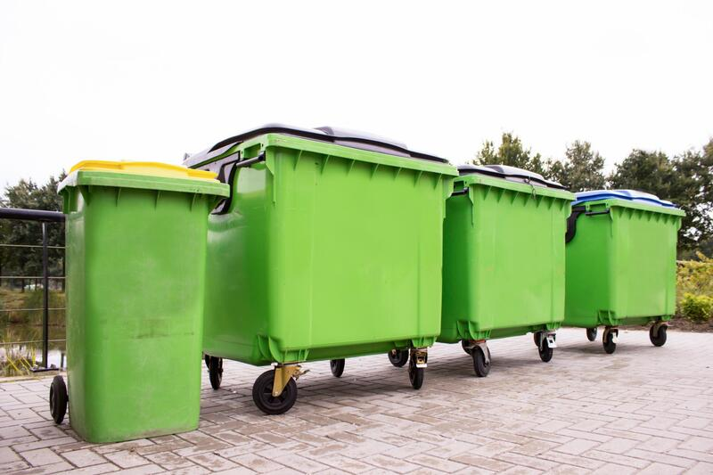 row of green dumpsters